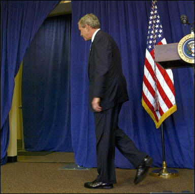 bush walks out on reporters